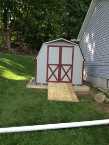 Slideshow Image - Light grey with red trim on optional site prep and longer ramp.